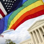 An American flag and a rainbow colored flag flies in front of the Supreme Court in Washington, Monday, April 27, 2015, as the Supreme Court is scheduled to hear arguments on the constitutionality of state bans on same-sex marriage on Tuesday. (AP Photo/Andrew Harnik)