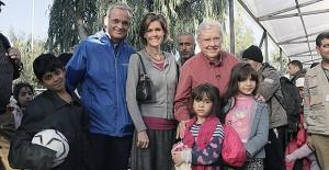 Elder M. Russell Ballard, Elder Patrick Kearon, and Sister Jennifer Kearon visit refugees on the Greek island of Lesbos.